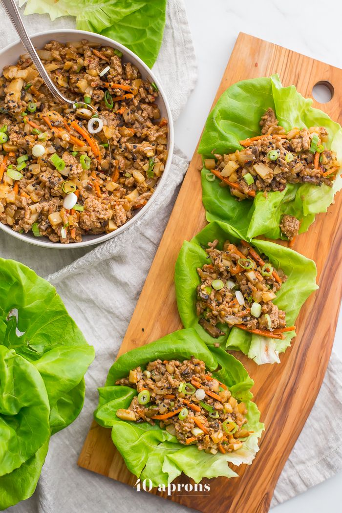 These Whole30 lettuce wraps are delicious, just like the PF Changs lettuce wraps recipe. Loaded with flavor, they're light yet filling and super easy!