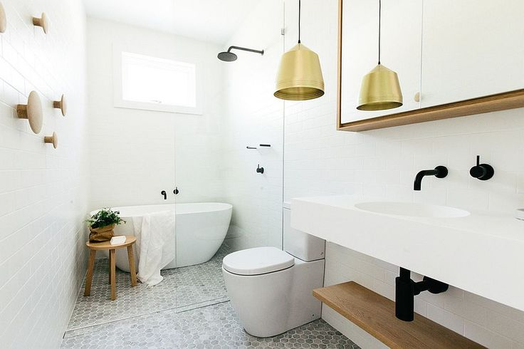 Pendant light adds warm metallic glint to the classy Scandinavian bathroom Seasonal Style: Hot Bathroom Trends to Try Out This Summer