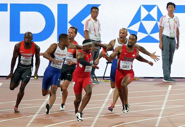 USA's relay team finishes second but disqualified after botched hand-off. | James Ellington of Great Britain and Tyson Gay of the United States change over to Chijindu Ujah of Great Britain and Mike Rodgers of the United States in the Men's 4x100 Metres Relay final during day eight of the 15th IAAF World Athletics Championships Beijing 2015 at Beijing National Stadium on August 29, 2015 in Beijing, China. (Photo by Lintao Zhang/Getty Images for IAAF)