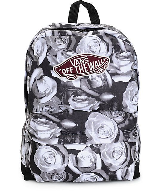 Get packing' in lush style with this mid-size backpack that features a black and white rose print exterior and ample storage space to keep all your stuff stored and secured.