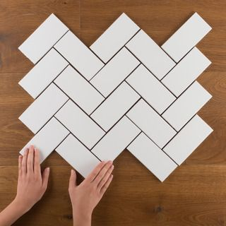 Try classic 3x6 subway tile in a herringbone pattern.