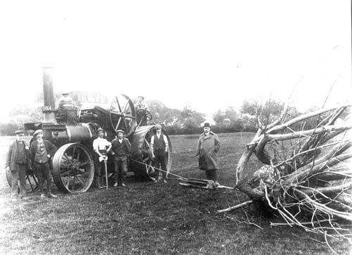 Salford Priors.  Agricultural machinery A steam driven engine winching a felled tree, Salford Priors. 1900s