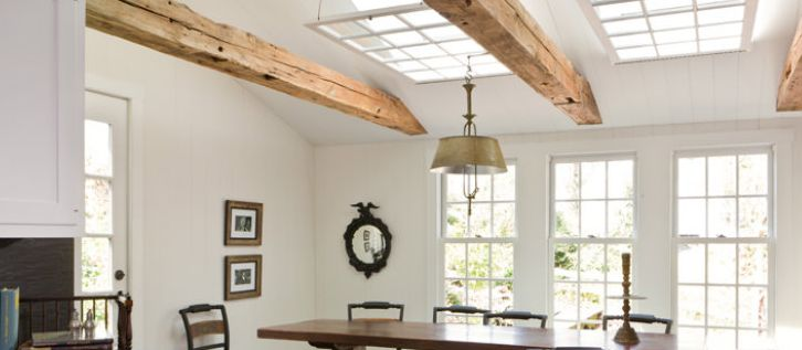 darryl carter + reclaimed wooden beam + skylight + white