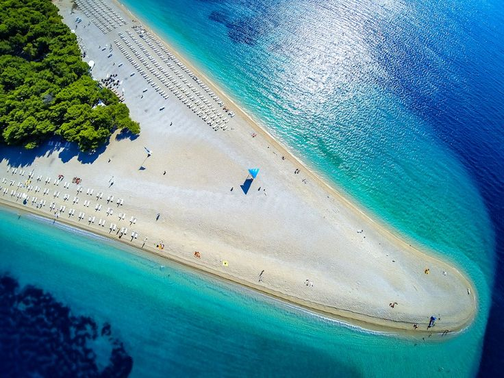 Croatia has no shortage of beautiful beaches, but Zlatni Rat stands out for its striking and unusual shape (which actually changes depending on the current). Though it looks like a golden sand beach, its shoreline is made up of smooth, tiny pebbles and stretches out for half a mile on either side of the tip. It's not just a place to lounge: Zlatni Rat is also a popular spot for windsurfing, jet-skiing, and stand-up paddle boarding.