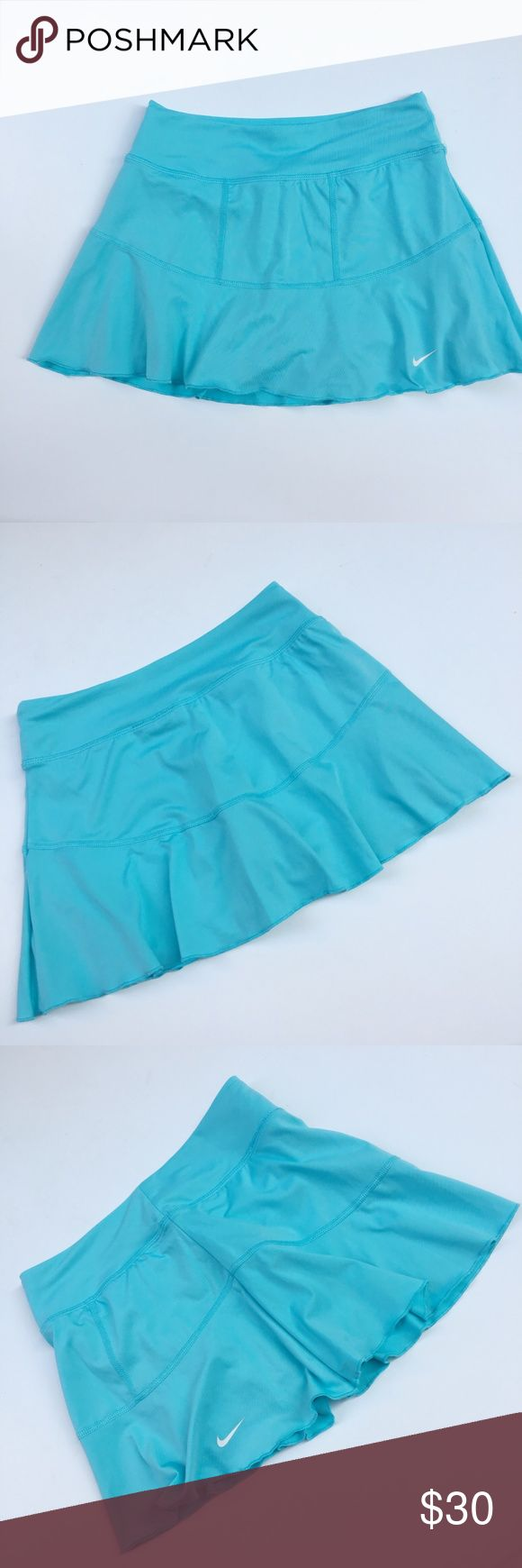 "Nike Tennis Skort Fit & Flare Mini Dri Fit XS WA9 Nike Women's Skorts Blue Dri-Fit Flare Flirty Skirt over Shorts, White Swoosh.  Elastic Waist Size: XS X Small  Waist: 11.25""  Inseam: 4"" Length: 11.5""  Condition: Very Good. Comes from a pet and smoke free environment!  Please review pictures and contact me if you have any questions. Color: Blue Country: Cambodia Care: Machine WT: 0.07 CSKU: WA009;  Measurements are approximate & taken flat Nike Shorts Skorts"