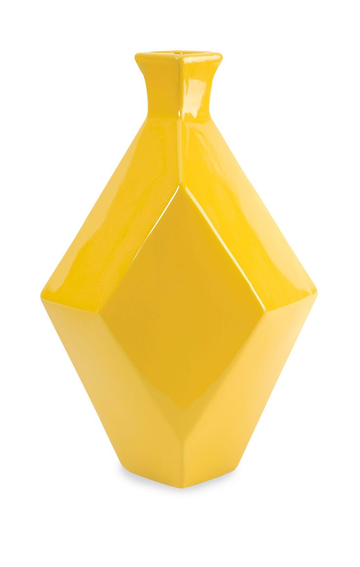 The Chantal large yellow vase incorporates a geometric shape and canary shade that adds a contemporary boldness to any room!