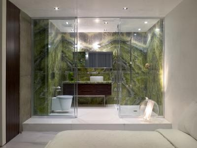 Sliding glass doors close off this compact bathroom, while still leaving its visual charms on display. The transparent light above the wall cabinet, and the see-through round lamp avoid blocking sight of the rear wall. #SanFrancisco home #interiordesign