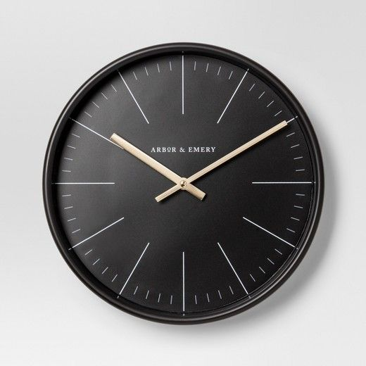 Sleek modern design and stylish practicality come together as one with this Decorative Clock from Project 62™. This simple and modern clock showcases an all-black face that's numberless and has stand-out hands and tick marks. Whether you're hanging this decorative piece alone as a centerpiece or mixed in with other wall decor on a gallery wall, this clock will tie your whole space together.<br><br>1962 was a big year. Modernist design hit its peak and moved into h...