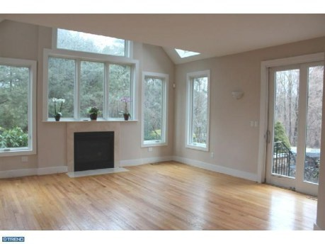 open airy living room so much light wood floors