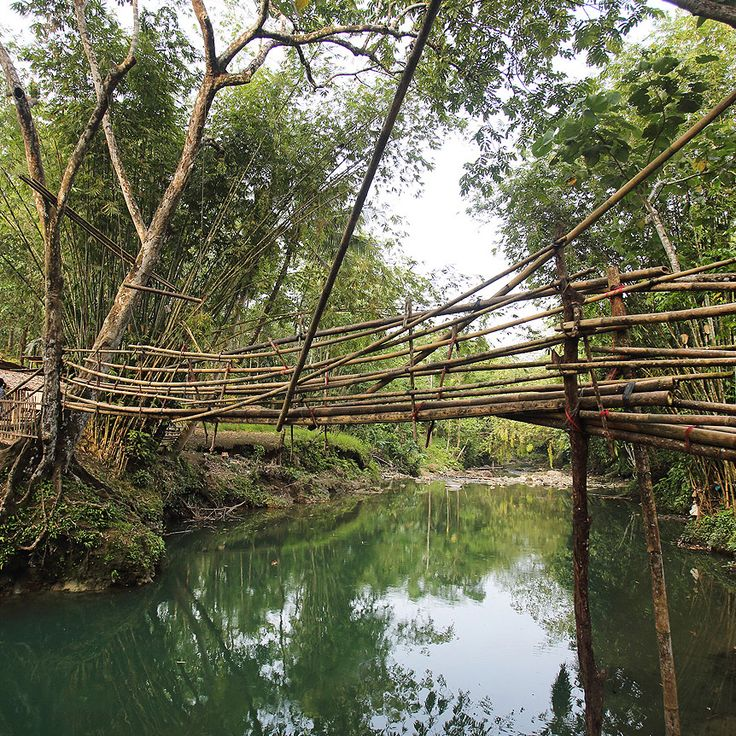 A rickety bamboo bridge in the interior of Nias Island, North Sumatra, Indonesia. Photo by Bjorn Svensson. www.visitniasisland.com