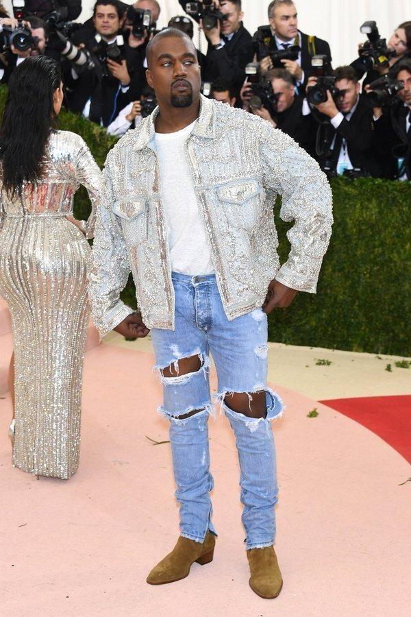 Kanye West wearing Fear of God Selvedge Denim in Vintage Indigo and Balmain Custom Embellished Denim Jacket