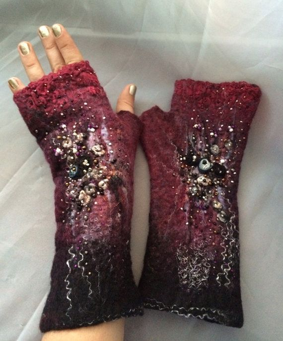 Beautiful fingerless gloves made put of merino wool and silk , lace , yarn, beads . Be a center of attention in those ! Stay cozy warm and stylish ..