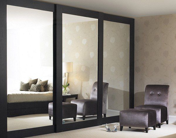Sliding mirrored closet doors get an updated look installed floor to ceiling.
