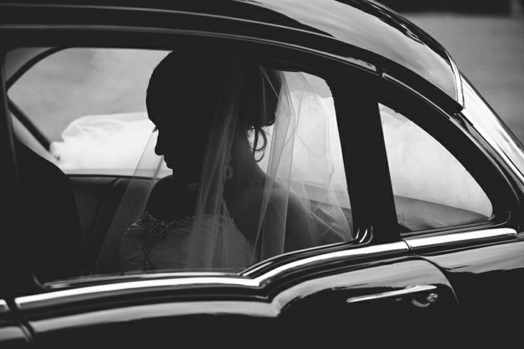 silhouette of a bride in a wedding car