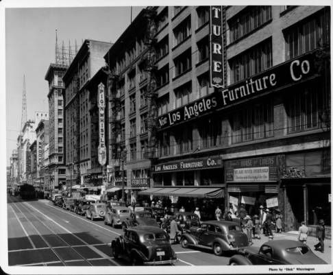 """Looking along the busy streets of downtown along Broadway :: """"Dick"""" Whittington Photography Collection, 1924-1987"""