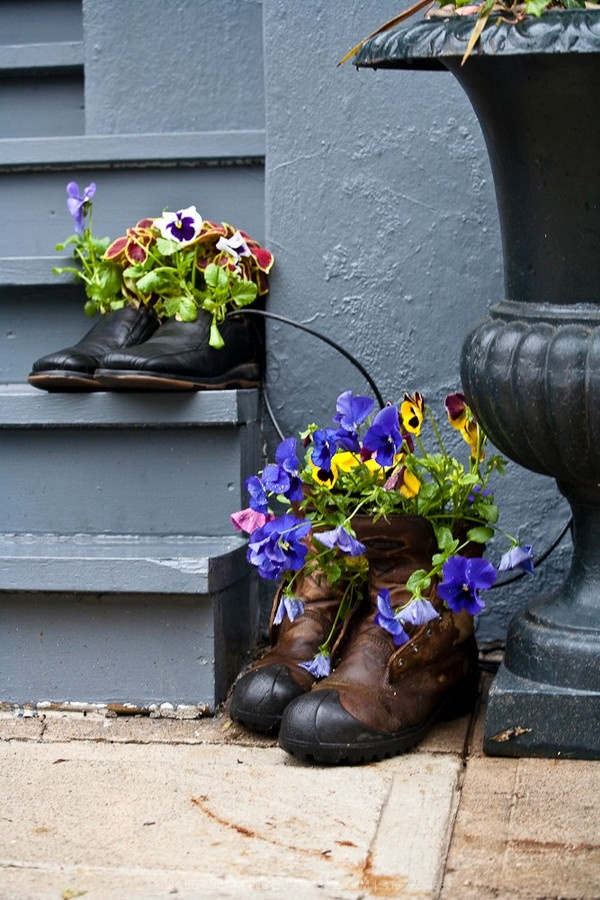 Worn work or cowboy boots repurposed into