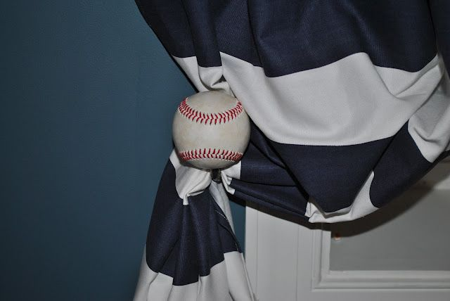 DIY Baseball Curtain Rod and Baseball Tieback. This would be WAY cute for a baby boys room!!