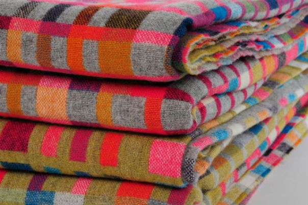 Holly Berry woven blankets. So many pretty colors!