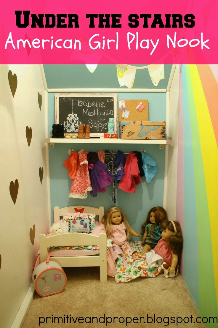 Awesome american girl nook with rainbow and gold vinyl hearts; great girl's play space under stairs