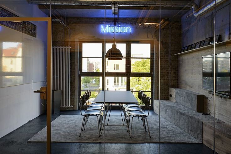 Neon signs with meeting room names.