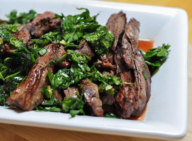 Grilled skirt steak with herb salsa verde.