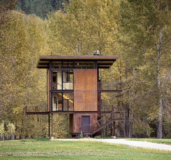 Industrial, utilitarian... The rust color helps the home find a subtle union within nature.