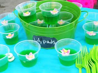 """The jello was simply green jello in clear cups with a marshmallow cut into fourths, dipped in colored crystal sugar to resemble a liilypad flower."""