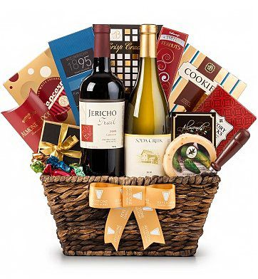 """Give the experience of California wine country with this beautiful gourmet gift basket featuring Soda Creek Chardonnay and Jericho Trail Proprietary Red. These two classically styled wines arrive with tasty foods for pairing, including Northwoods Jalapeno Jack Cheese, Rosemary & Garlic Crackers, Toffee Peanuts, and more. Weighs 12lbs / Measures 14"""" x 13"""" x 7""""."""