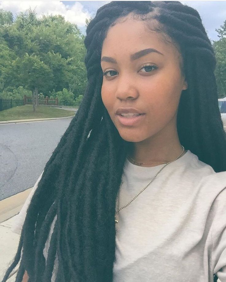 dreads and p.s. she is apart of  group called wercharm and she can really sing