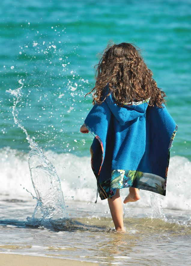 Sun of a Beach Kids Poncho: Our cozy beach poncho for mini explorers! Fluffy towel with cool printed details.