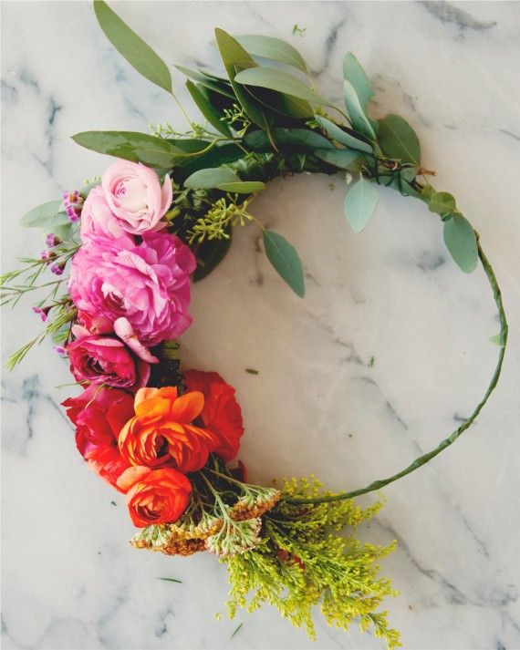 At your garden party bridal shower, guests will have no problem creating this floral accessory, thanks to the easy method shared by The Kitchy Kitchen's Claire Thomas. More