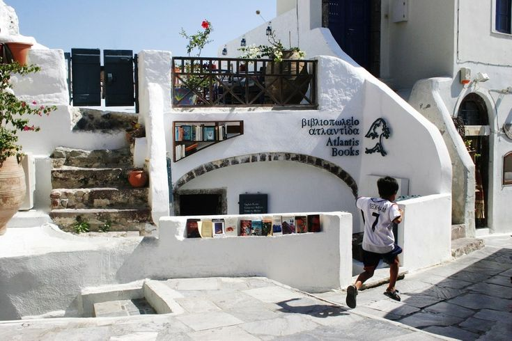 Atlantis Books in Santorini, Greece | Stepping into Atlantis Books is a bit like going into a cave, but one filled with tons of character! There are notes and messages written all over the walls, and they host food festivals, film festivals, and book signings regularly.