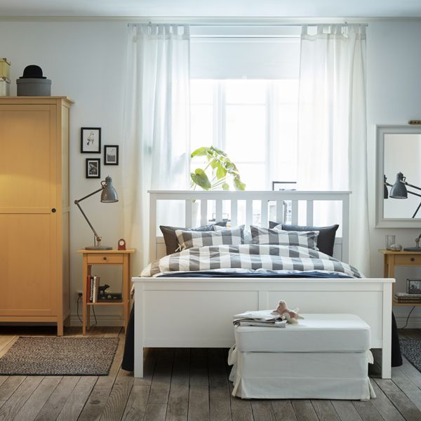 A Light Medium Sized Bedroom Furnished With A White Bed For Two Combined  With Bedside Tables And A Wardrobe In Yellow Stained Solid Pine. Ikea  Bedroom ...