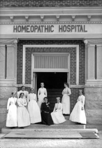 A group of student nurses at the entrance of Denver Homeopathic Hospital at Park Avenue and Humboldt Street in the City Park West neighborhood of Denver, Colorado - year 1910.