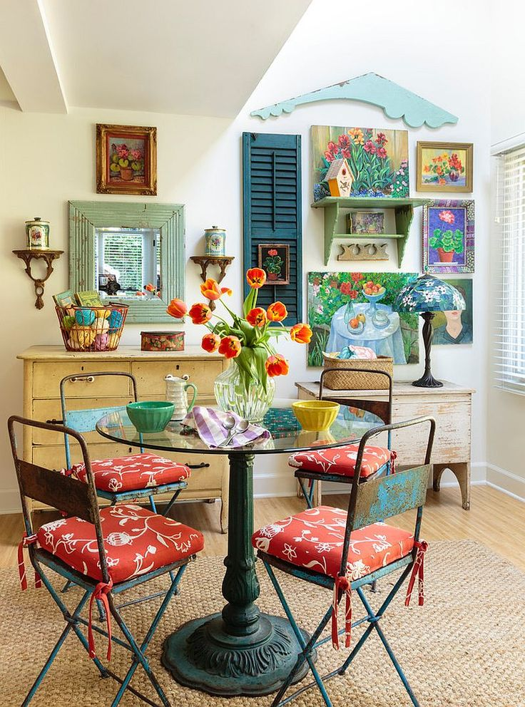 Which one of these fabulous dining room decorating ideas will inspire you? Dining room decorating ideas, including light fixtures, dining room tables, dining room chairs, dining room flooring, and more. Black and white kitchen with small round table and two chairs in the corner. A blue, brown and green dining room setting with a yellow sofa in the background.