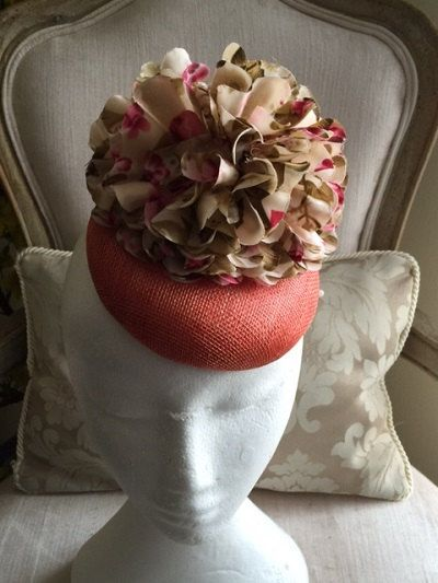 Stunning coral round base fascinator with a multi coloured saltin flower by CanteringDesigns on Etsy