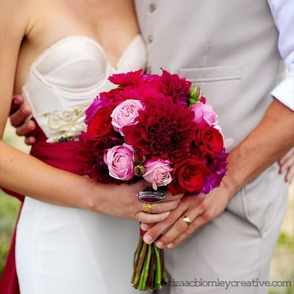beautiful wedding bouquet held by bride and groom