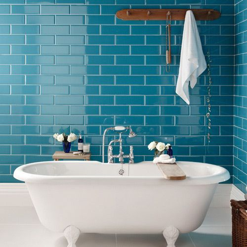 peacock inspired bathroom wall tile nicely contrasts the tub makes a bold statement - Colorful Subway Tile