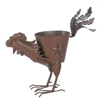 """<p>Let this whimsical rooster strut his stuff in your yard this summer. Made from iron with a weathered brown finish, the planter features a lone star and the roosters tail feathers stand at attention! Planter: 7"""" x 5"""" x 5 1/4"""" high. Iron</p>"""