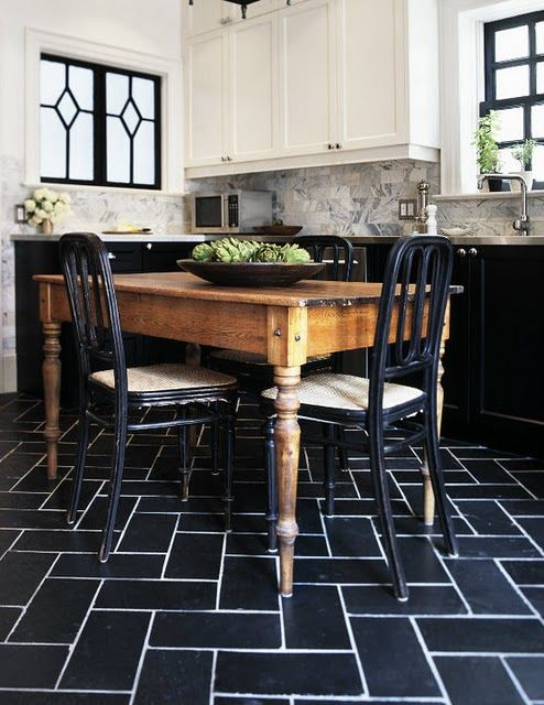 Black floor tiles with white grout, Marble subway tiles, white marble countertops, farmhouse table