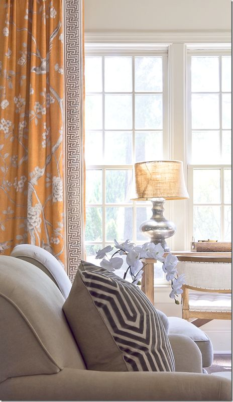 The detail on the leading edge of the draperies in correlation with the accent pillow.