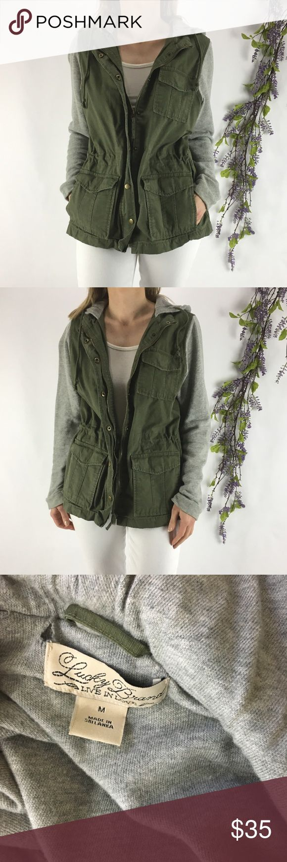 "LUCKY BRAND Green Military Jacket w/ Terry sleeves LUCKY BRAND Green/Gray 100% Cotton French Terry Sleeves/Hood Military Jacket  A study in comfy contrast, our French Terry Military jacket combines a cozy fabric with tough details for a jacket you'll want to wear all around town (plus we're loving the longer silhouette and the French terry hood).  Sleeve Style: Long  Material: 100% Cotton  UNSTRETCHED MEASUREMENTS:  Armpit to armpit 19""  Length 25"" Lucky Brand Jackets & Coats Utility Jackets"