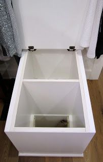 Little bench in closet is actually a laundry chute