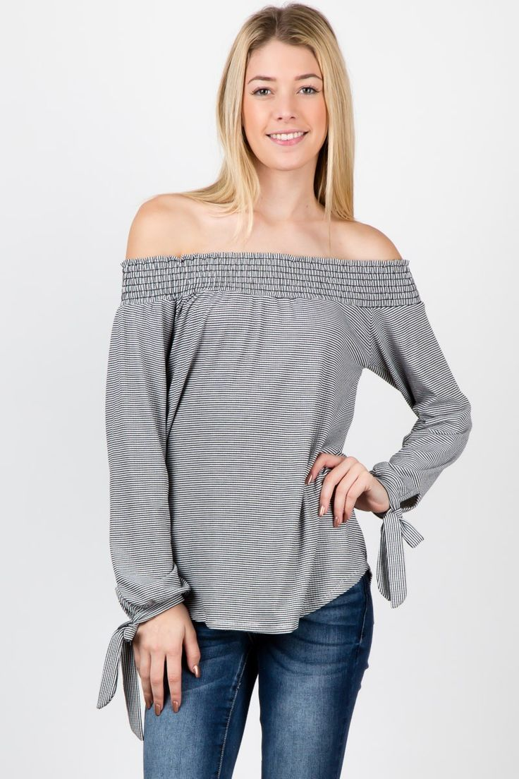 Ivory/black open shoulder long sleeve striped straps at the end of the sleeves! #fashion #USA #streetwear #streetstyle #streetfashion #trend #outfit #fashionweek #fashionshow #beauty #SleevelessTop #Jacket