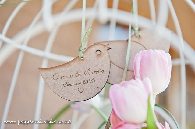 Little laser cut birds engraved with Octavia & Aurelia add to the personal decor of the Christening.    https://www.facebook.com/RubyGreyCreative