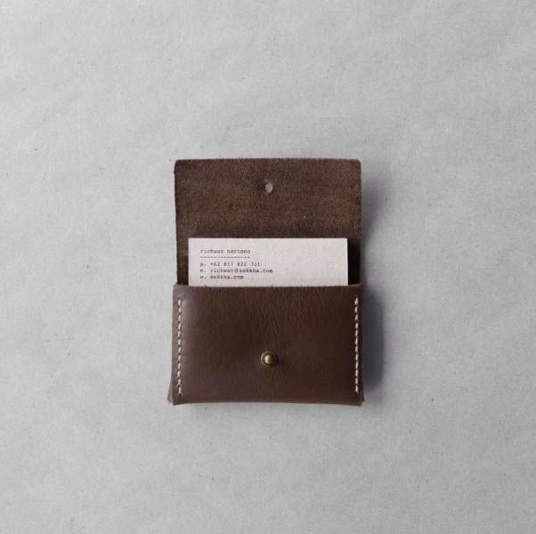 Leather card holder constructed from a single piece coffee brown pull-up leather