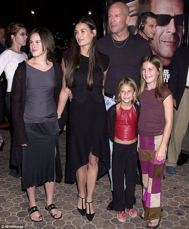 Happy family: She had three children with Bruce Willis before they divorced in 2000...