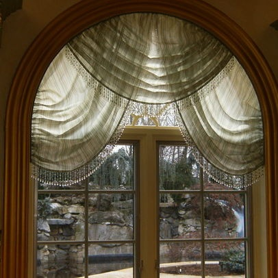 Looking for inspiration for an arched window treatment - this one is pretty although I wouldn't do sheer - this would be very pretty I think with coordinating fabrics.