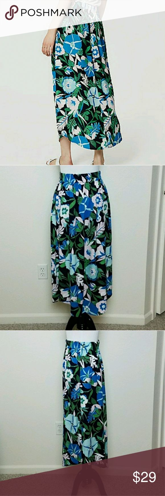 Loft Jungle Floral Long Black Maxi Skirt Loft Jungle Floral Long Maxi Skirt  Size: XS Petite   Light and flowy maxi length skirt with a tropical flower pattern  Elastic waistband, shirt tail hem, side slit pocket, and side slits  Excellent pre-owned condition LOFT Skirts Maxi