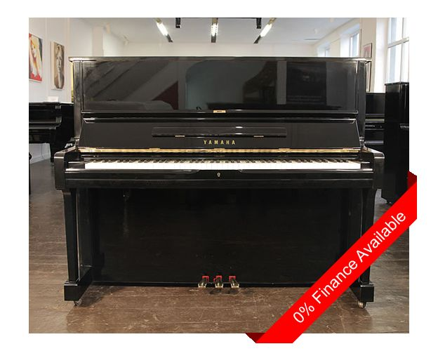 A 1983, Yamaha U1 upright piano with a black case and polyester finish at…